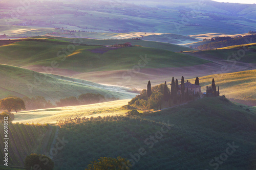 Foggy morning over rural house in San Quirico d'Orcia,Italy © Shchipkova Elena