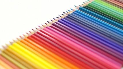 Woman hand pick up the color pencil arrange on white desk