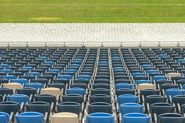 Stadium seats and green grass
