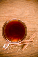 black tea in glass with cinnamon and cane sugar