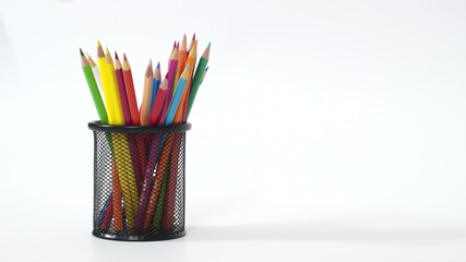 Hand put color pencils into metal basket