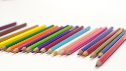 Throwing Color Pencils to white desk, from 3 angles shots