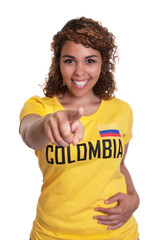 Pointing young woman from Colombia