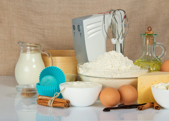 Mixer, cake pan, spices, eggs and dairy products