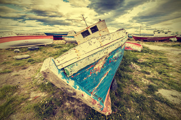 Old boat wreck, vintage retro style.