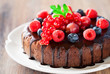 Chocolate cake with fresh berries, selective focus