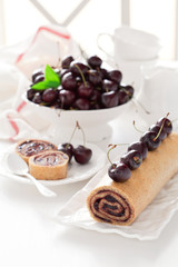 Cake roll with cherry jam, selective focus