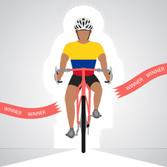 Colombian cyclist in front view crossing red finish line