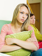 Senior woman and adult daughter having conflict