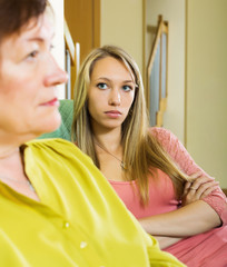 Mature woman and adult daughter having conflict