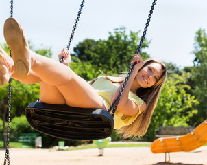 Girl on swing in summer