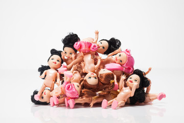 plastic dolls on white background