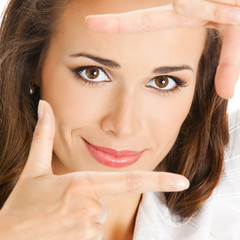 Businesswoman framing her face with hands, isolated