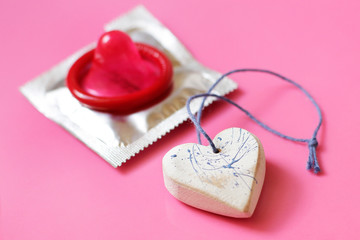 Heart and red condom