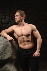 Athletic man on black backgrounds