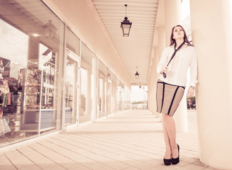 stylish woman in office clothes at city business center