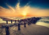 Vintage retro photo of beach at sunset. - 66826130