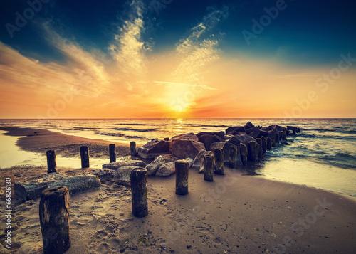 Vintage retro photo of beach at sunset.