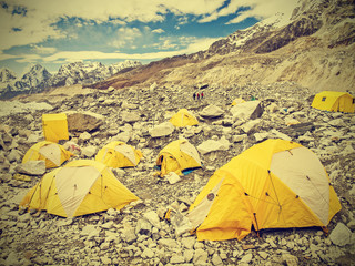 Tents in Everest Base Camp in cloudy day, Nepal, vintage retro s