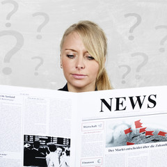 Woman reading newspaper is anxious