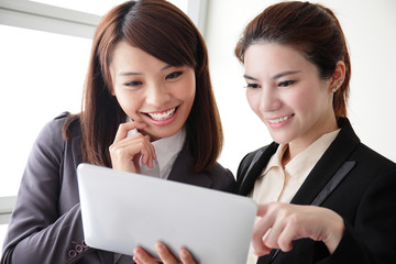 Business women smile conversation