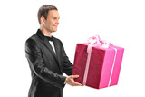 Handsome young man holding a big gift