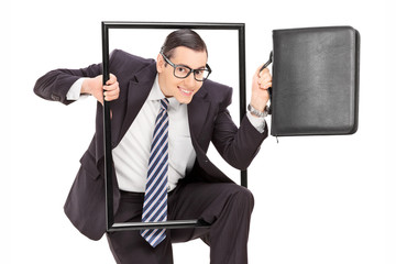 Businessman walking through a frame