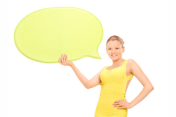 Elegant woman holding a blank yellow speech bubble