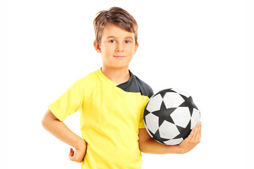 Male junior athlete holding a football