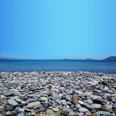 Beach with pebbles and blue sea Sitia Crete