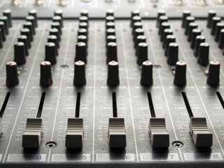 Mixing desk  faders and knobs