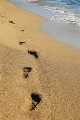 Sandy shoreline with footprints Falasarna Crete