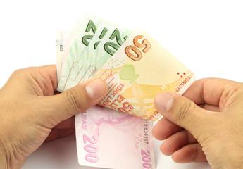 Counting money .Turkish banknotes. Turkish Lira ( TL )