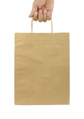 Man hand carries shopping bag on white background.