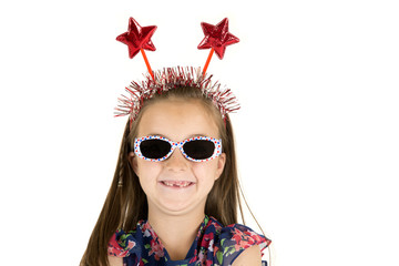 girl missing front teeth with patriotic red star headband
