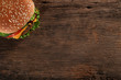 Tasty hamburger on wood background. Space for text - 66830333