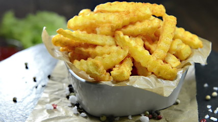 Portion of homemade French Fries (not loopable rotating video)