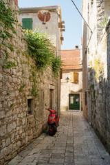 Narrow street of historic Stari Grad, Hvar island, Croatia