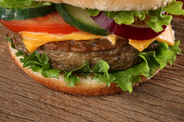 Close up of a tasty hamburger on wood background