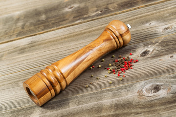 Wooden Pepper Mill on Rustic Wood