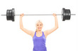 Blond female athlete lifting a heavy barbell