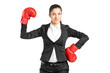 Businesswoman with boxing gloves posing