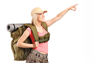 Female hiker pointing with hand