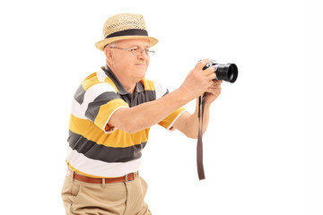 Mature man taking a picture with a camera