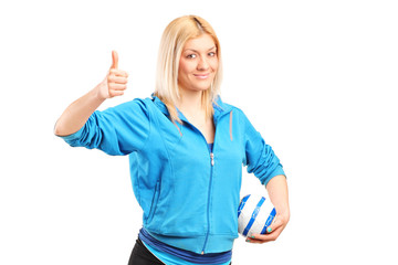 Professional female handball player giving thumb up