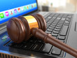 Online internet auction. Gavel on laptop.