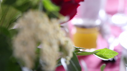 Jar with honey on a wedding decorated table, closeup