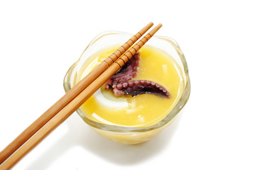 Tentacle Soup Served in a Glass Bowl with Chopsticks