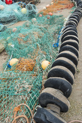Fishing nets lying on quayside