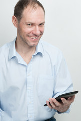 Smiling young man with tablet computer on white background